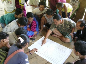 Indigenous people inside a Thai wildlife sanctuary discuss results of wildlife population monitoring that was conducted with collaboration of ecologists and sanctuary officials. Photo: Robert Steinmetz