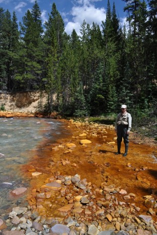 Iron precipitates visible in this highly impacted stream. Photo: Peter Leipzig-Scott.