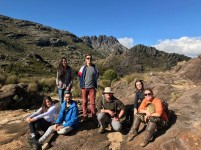 Rafael Zenni's lab group have just come back from the Itatiaia National Park, in Southeast Brazil, where they have been sampling non-native animals and plants along the Park's trails and roads. Their goals are to evaluate the risk of non-native species becoming invasive in the park's natural ecosystems and to develop a prioritisation tool for the management of non-native species in protected areas. Here they are at the Abrigo Rebouças (Rebouças refugee) with the Pico das Agulhas Negras (Agulhas Negras Peak) behind. The projected is funded and supported by ICMBio and CNPq-Brazil, and they are the Laboratory for Biological Invasions and Conservation from the University of Lavras, Brazil.
